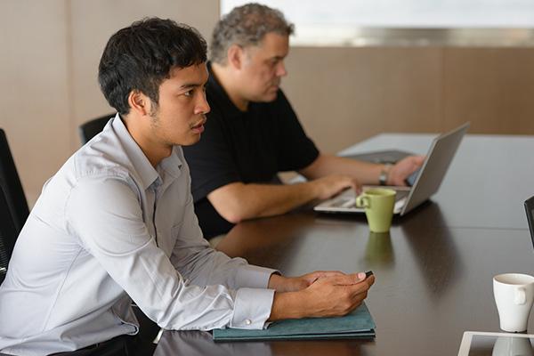 _0002_multi-ethnic-business-people-having-meeting-inside-JEJUPKD