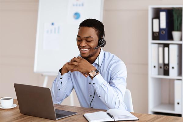 _0004_happy-black-man-having-online-training-office-inte-C247XRS
